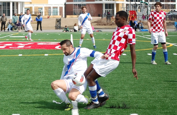 RWB Adria's Semir Mesanovic (left) working hard against Croatian Eagles in Chicago (photo: Scott Fenwick)