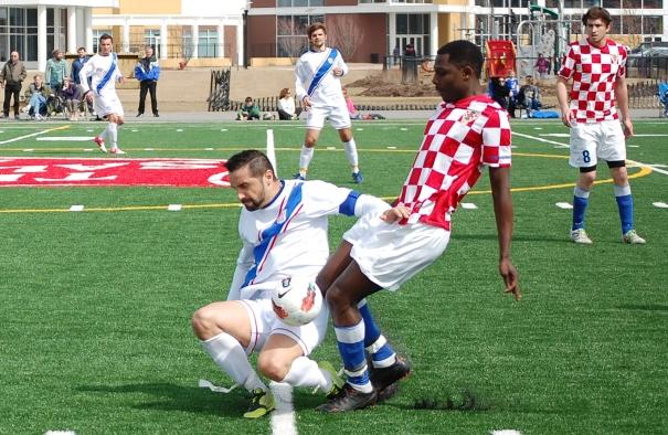 RWB Adria's Semir Mesanovic (left) working hard against Croatian Eagles in Chicago (photo: Scott Fenwick)