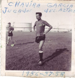 "Photo shows ""El Chavira at soccer practice - Todd Park in East Chicago. Note the Oil tank farm in the background. My father's hand written note in Spanish reads: Chavira Garcia, Azteca player. 1956-1957-1958"
