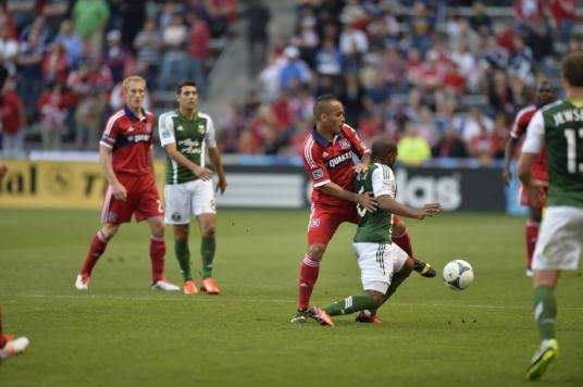 Alex applying pressure in the midfield (source: facebook.com/chicagofire)