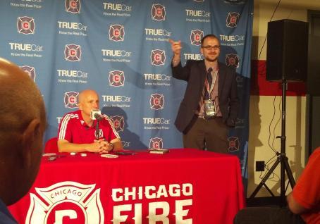Assistant Coach Matt Matkovich talks to reporters as Dan Lobring looks on. (Photo by Adam Morgan)