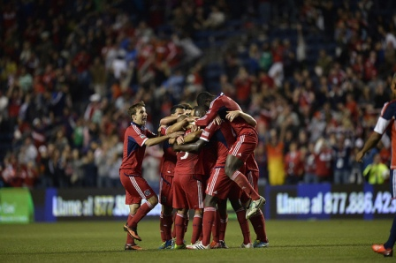 The team piles on Alex after his game-winning rocket. (photo by chicago-fire.com)