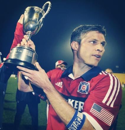 Then captain Logan Pause hoists the 2013 Carolina Challenge Cup (photo: @ChicagoFire)