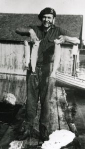 ernest-hemingway-poses-with-trout-caught-at-horton-bay-in-1919-or-1920-a396b20e5358fabe_large