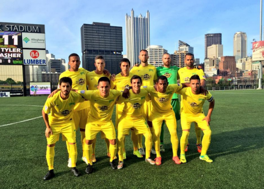 Pittsburgh skyline behind the Rowdies (rowdiessoccer.com)
