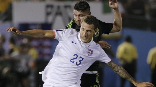 United States' Fabian Johnson (23) is challenged by Mexico's Oribe Peralta during the CONCACAF Cup match (via BostonHerald.com)