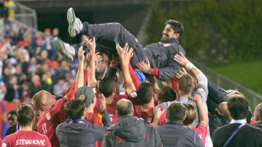 Members of the team from Serbia lift their coach Veljko Paunovic into the air as they celebrate after defeating Brazil in the final of the U20 Soccer World Cup in Auckland, New Zealand